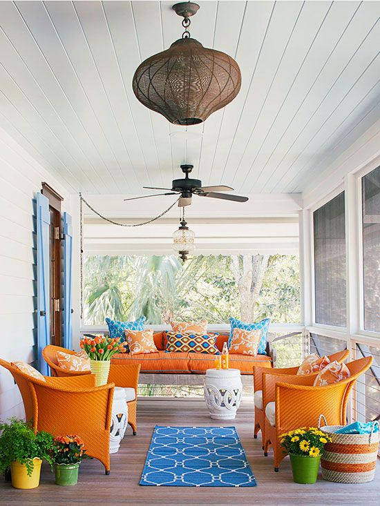 colorful summertime patio with blue rug and orange chairs